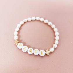 Bracelet perles eau douce et croix...
